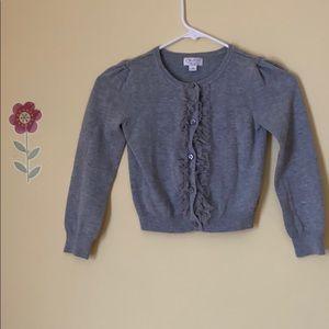 Children place sweater